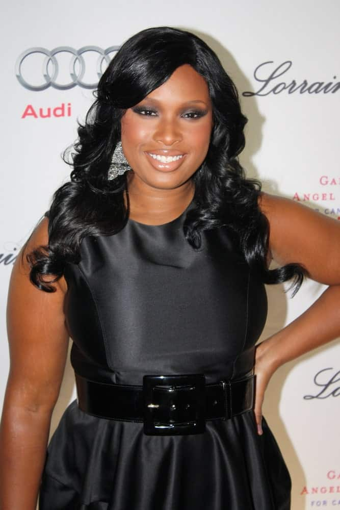 Jennifer Hudson attended the 2009 Angel Ball on October 20, 2009 in New York City. She came wearing a black dress with her long and curly raven hairstyle with long side-swept bangs.