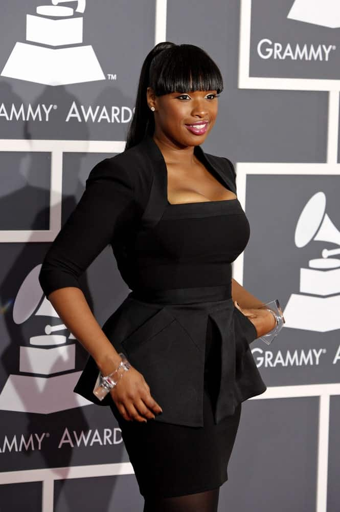 Jennifer Hudson attended the 52nd Annual Grammy Awards held at Staples Center in Los Angeles, California on January 31, 2010. She came in a black dress that she paired iwth a long raven ponytail hairstyle with blunt bangs.