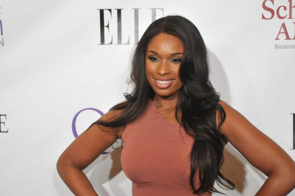 Actress Jennifer Hudson attended the 2nd Annual Mary J. Blige Honors Concert on May 1, 2011 - Hammerstein Ballroom in New York, NY. She was charming in a peach dress that she paired with her long and wavy layered raven hairstyle with a slight tousle.