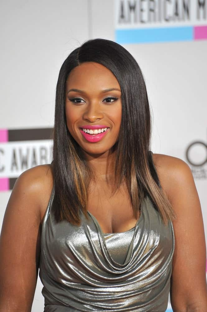 Jennifer Hudson was at the 2011 American Music Awards at the Nokia Theatre, L.A. Live in downtown Los Angeles on November 20, 2011. She paired her silver dress with a long and straight highlighted hairstyle.