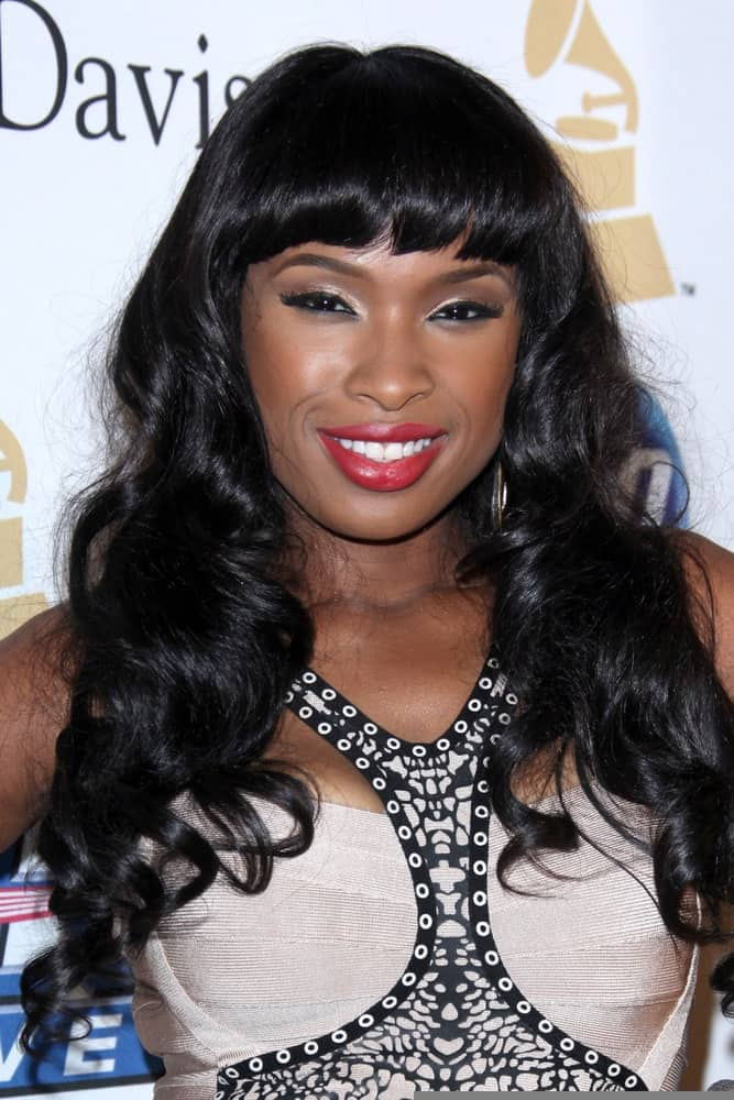 Jennifer Hudson was at the 2011 Pre-GRAMMY Gala And Salute To Industry Icons at Beverly Hilton Hotel on February 12, 2011 in Beverly Hills, CA. She paired her stunning dress with a long and tousled curly raven hairstyle with blunt bangs.