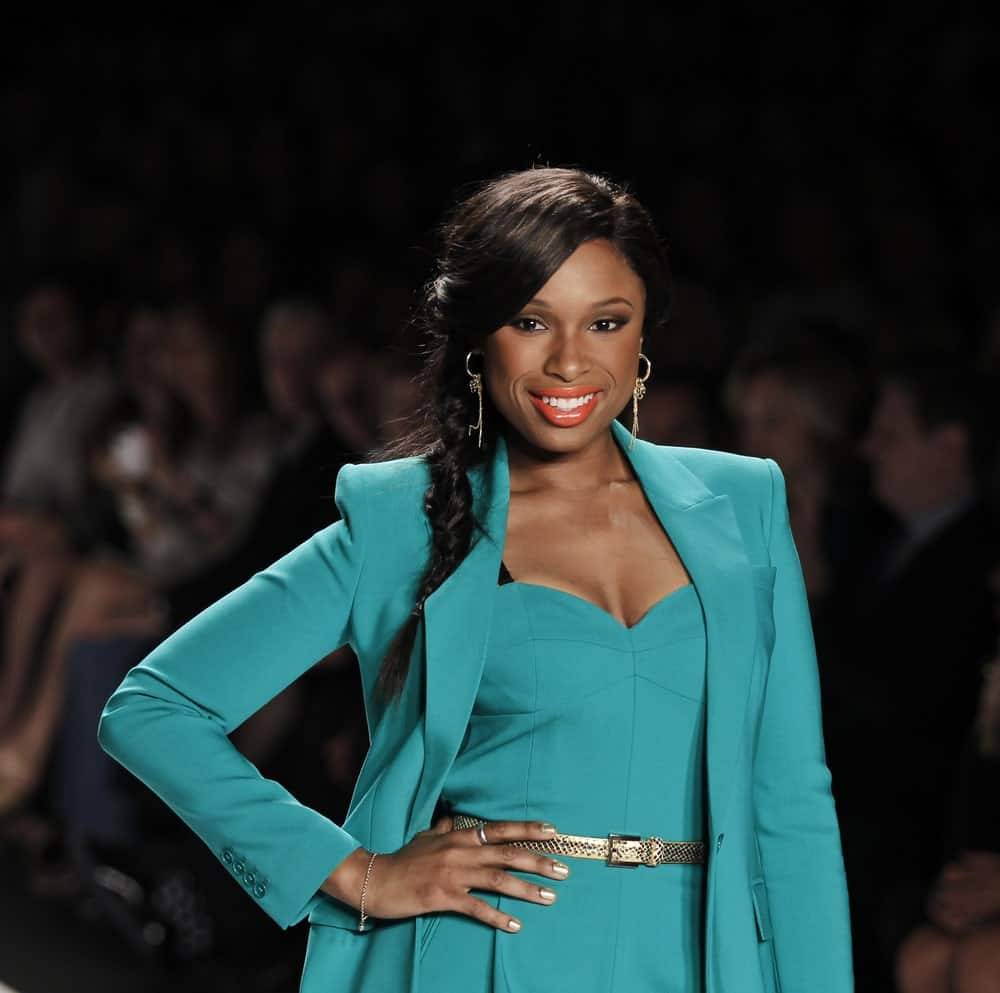 Jennifer Hudson walked the runway for Project Runway Collection during Spring/Summer 2013 at Mercedes-Benz Fashion Week on September 07, 2012 in New York. She wore a green formal attire with her long raven hairstyle with a fishtail braid.