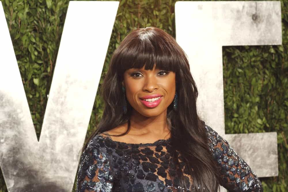 Jennifer Hudson attended the Vanity Fair Oscar Party at Sunset Tower on February 24, 2013 in West Hollywood, California. She was stunning in a black dress that she topped with a long, loose and tousled dark hairstyle with blunt bangs.