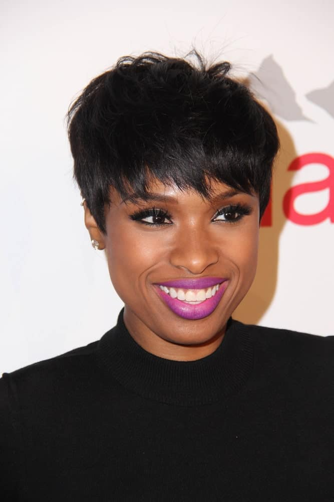 Jennifer Hudson attended the Fulfillment Fund Stars Benefit Gala 2014 at Beverly Hilton Hotel on October 14, 2014 in Beverly Hills, CA. She paired her all-black outfit with a raven pixie hairstyle with layered bangs.