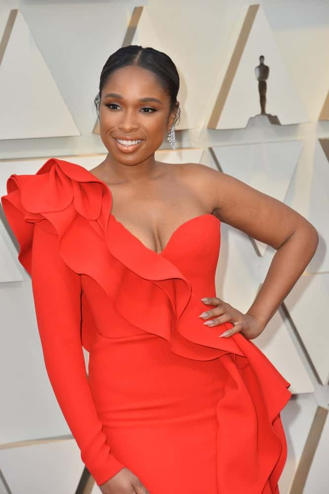 On February 24, 2019, Jennifer Hudson attended the 91st Academy Awards at the Dolby Theatre. She wore an elegant red dress that she paired with her slicked-back raven hairstyle.