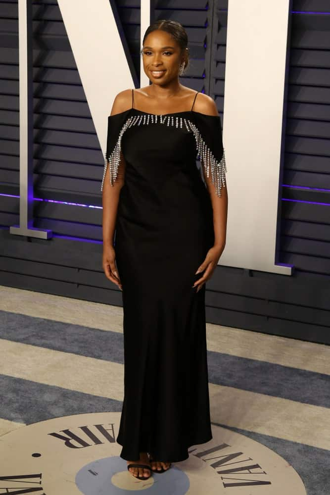 Jennifer Hudson was at the 2019 Vanity Fair Oscar Party on the Wallis Annenberg Center for the Performing Arts on February 24, 2019 in Beverly Hills, CA. She was seen wearing an elegant black dress with her slicked back bun hairstyle.