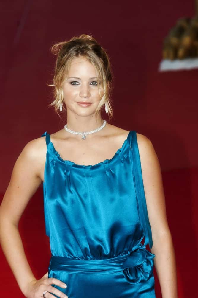 Young actress Jennifer Lawrence attended The Burning Plain premiere held at the Sala Grande during the 65th Venice Film Festival on August 29, 2008 in Venice, Italy. Her shiny blue dress was paired with a messy bun hairstyle that has loose tendrils and bangs.