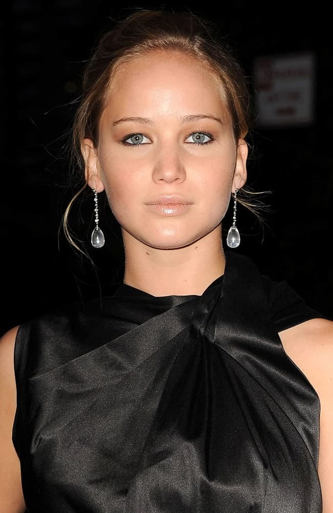 Jennifer Lawrence wore a beautiful black outfit with her messy bun hairstyle that has loose tendrils at THE BURNING PLAIN Premiere, Landmark Sunshine Cinema in New York, NY on September 16, 2009.