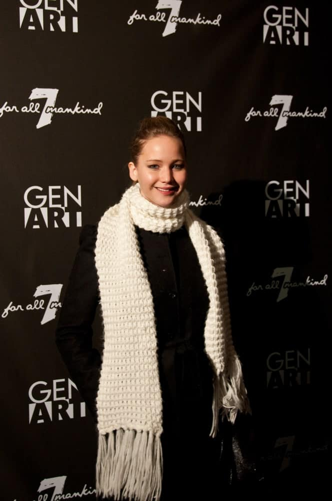 Actress Jennifer Lawrence wore a large white scarf on her black winter outfit when she attended the GenArt 7 Fresh Faces in Film at the Sky Lodge on January 22, 2010 in Park City, Utah. She paired this with a simple brunette ponytail hairstyle and bright smile.
