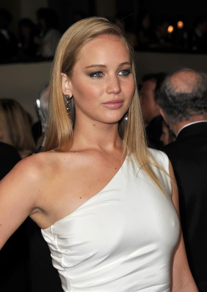 Jennifer Lawrence paired her charming white dress with a long and straight blond hairstyle incorporated with side-swept bangs at the 63rd Annual Directors Guild of America Awards at Hollywood & Highland on January 29, 2011 in Los Angeles, CA.