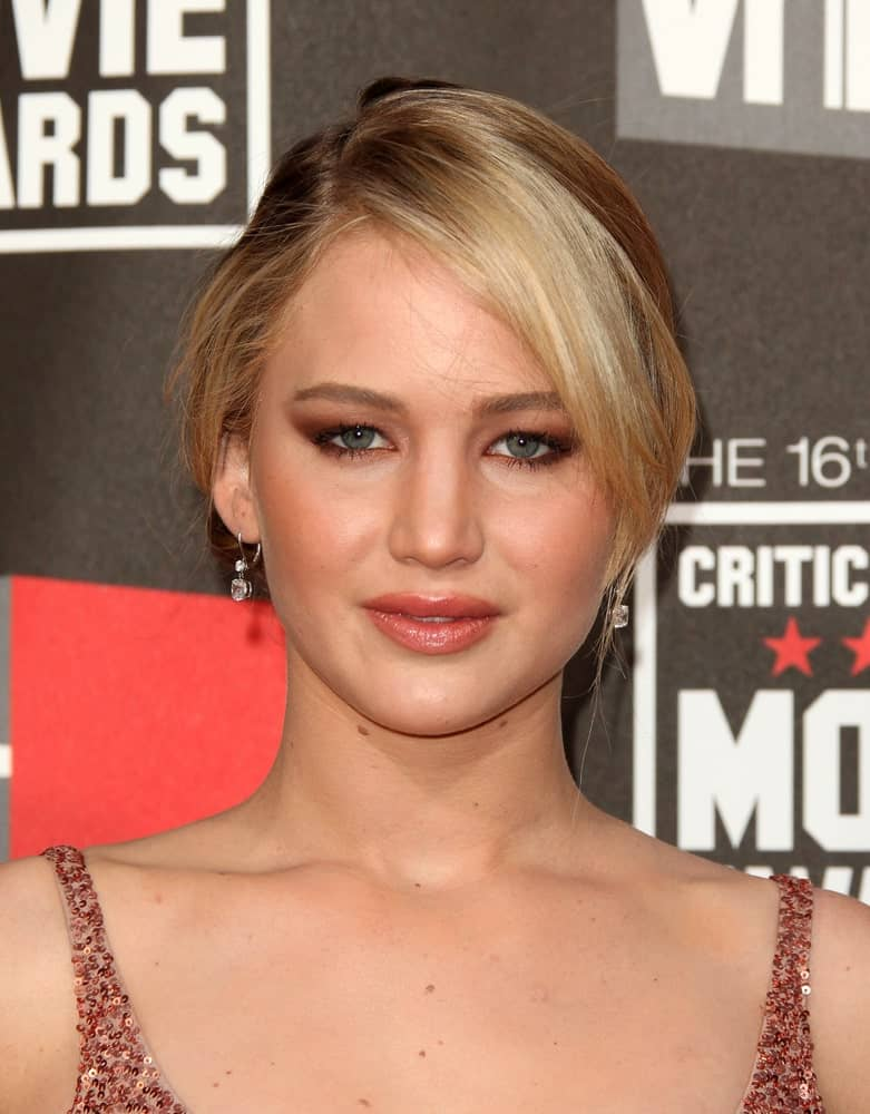 Jennifer Lawrence's sexy sequined dress was a perfect match for her bun hairstyle that has loose side-swept bangs and highlights at the 16th Annual