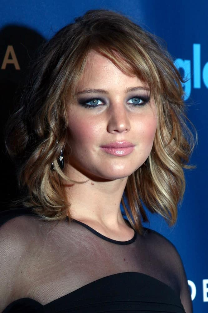 Jennifer Lawrence was at the 2013 GLAAD Media Awards at the JW Marriott on April 20, 2013 in Los Angeles, CA. Her elegant black sheer dress was a perfect fit for her loose and tousled wavy layered bob hairstyle with highlights.