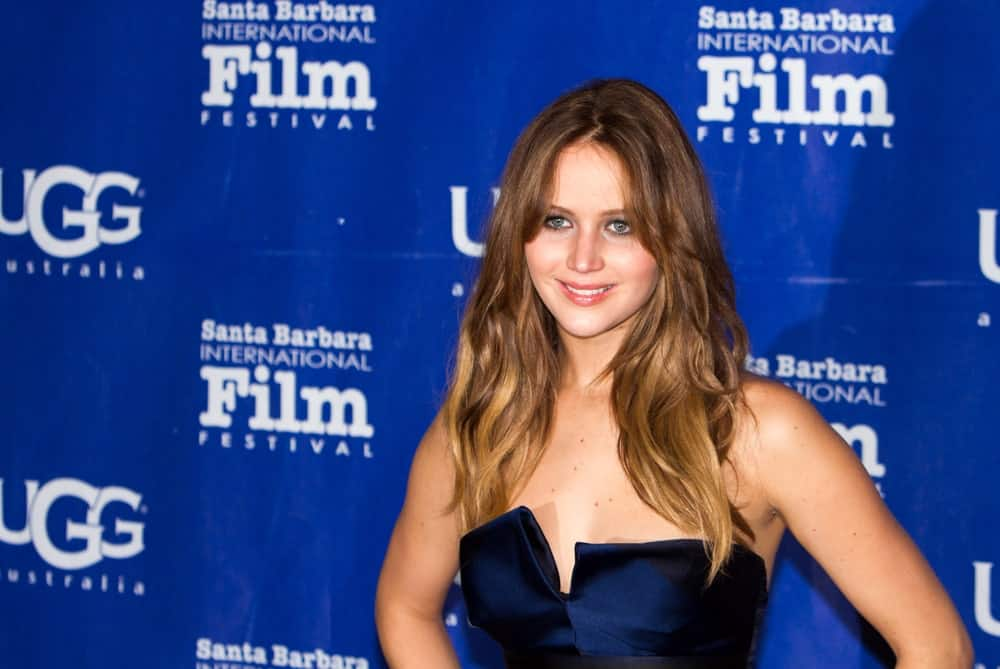 Oscar winner Jennifer Lawrence attended the red carpet at the 28th Santa Barbara International Film Festival in Santa Barbara CA on February 02, 2013. Her long hair was layered, highlighted and incorporated with center-parted curtain bangs.