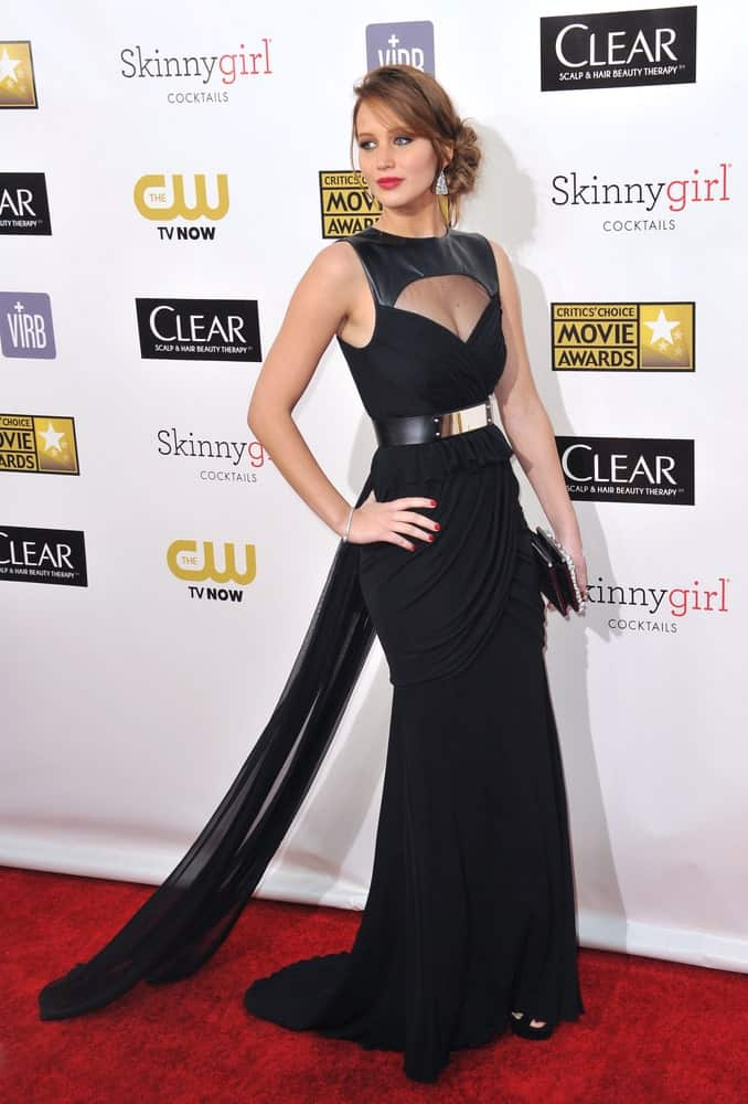 Jennifer Lawrence wore a gorgeous black long dress with her elegant low bun hairstyle with loose tendrils and a messy finish at the 18th Annual Critics' Choice Movie Awards at Barker Hanger, Santa Monica Airport on January 10, 2013.