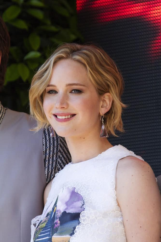 Jennifer Lawrence attended 'The Hunger Games: Mockingjay Part 1' Photocall - at the 67th Annual Cannes Film Festival on May 17, 2014 in Cannes, France. She came wearing a simple white outfit that went well with her short and tousled highlighted hairstyle.