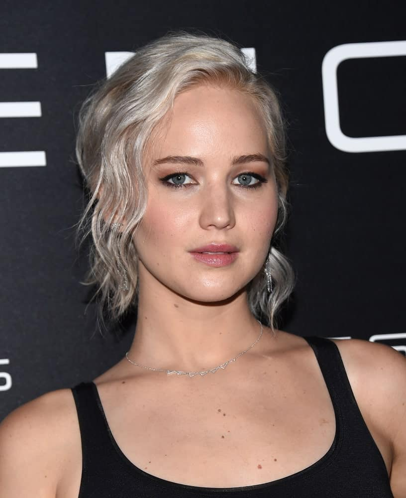 Jennifer Lawrence paired her white blond wavy ponytail hairstyle with a simple black outfit when she arrived at the Cinema Con 2016: Sony Pictures Presentation on April 12, 2016 in Las Vegas, NV.