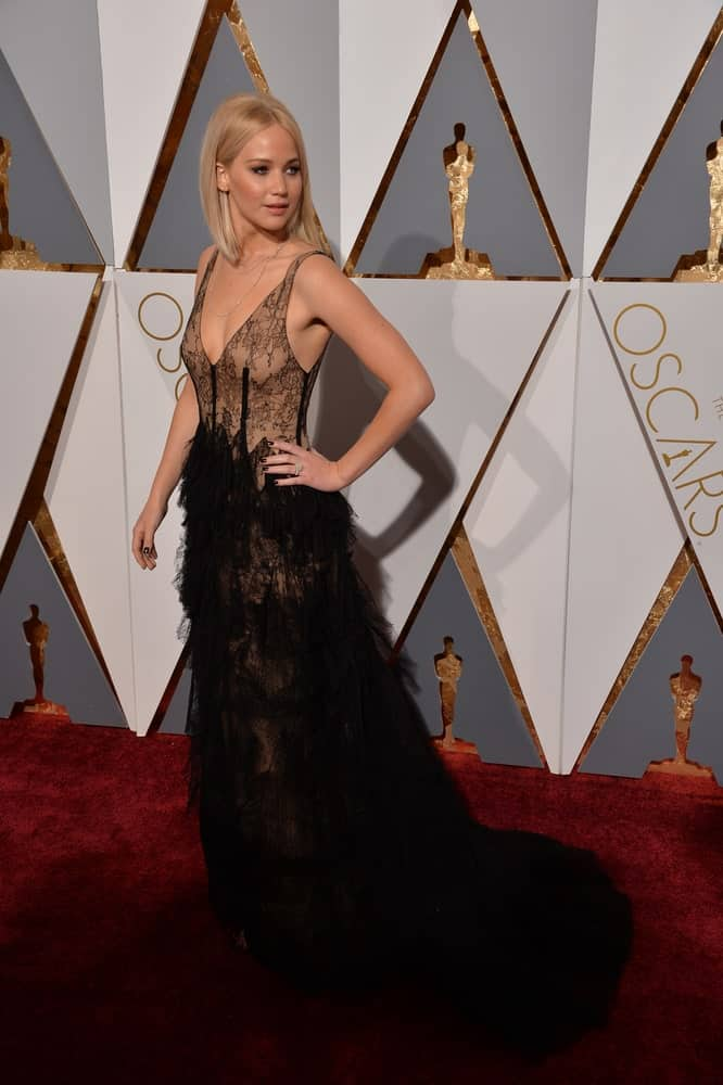 On February 28, 2016, Jennifer Lawrence's sexy black sheer dress was complemented by her straight blond hair on her shoulders at the 88th Academy Awards at the Dolby Theatre, Hollywood.