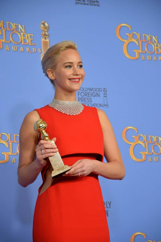 On January 10, 2016, Jennifer Lawrence was brimming with pride as she held her trophy at the 73rd Annual Golden Globe Awards at the Beverly Hilton Hotel. She wore an elegant red dress that she paired with a slick upstyle and bright smile.