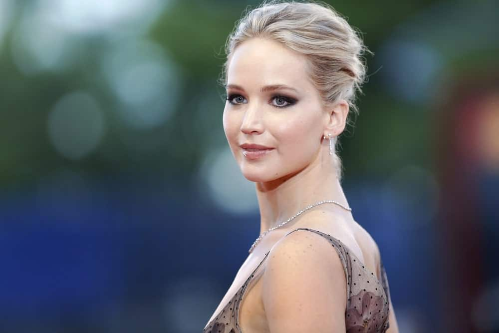 Jennifer Lawrence was quite elegant and lovely in her floral dress and tousled loose upstyle blond hair when she attended the red carpet of the movie 'Mother!' during the 74th Venice Film Festival on September 5, 2017 in Venice, Italy.