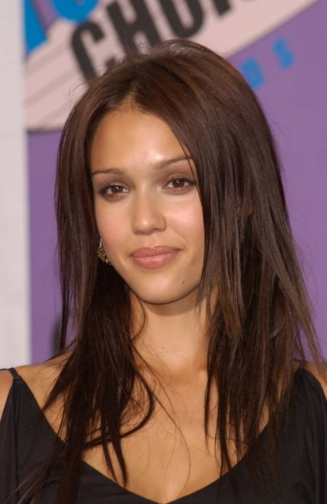 Actress Jessica Alba paired her black outfit with an equally dark and tousled long straight hairstyle that is center-parted and layered at the 2001 Teen Choice Awards at the Universal Amphitheatre, Hollywood. She won the award for Choice TV Actress.