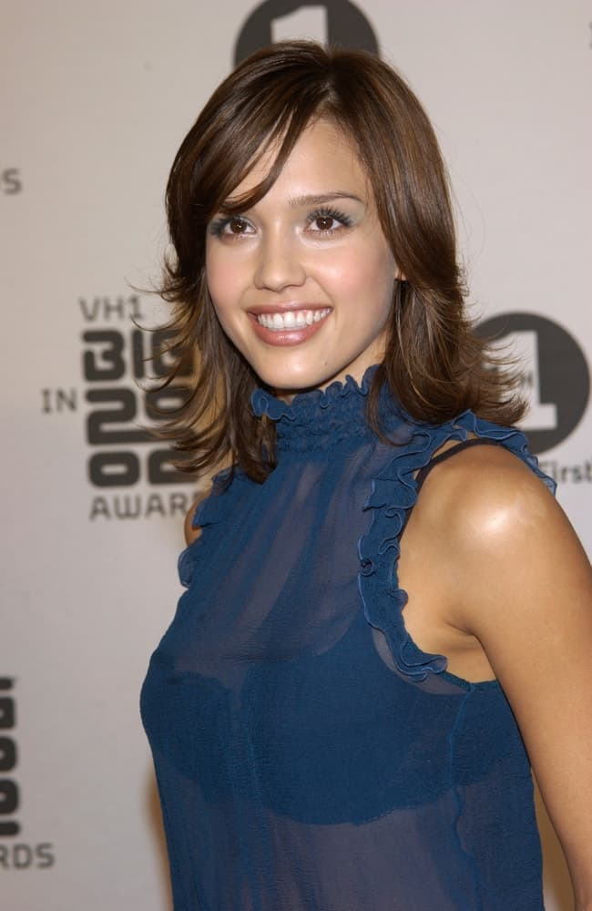 On December 4, 2002, Jessica Alba was quite stunning in her sheer outfit and shoulder-length dark brown layered hairstyle that has long side-swept bangs at the VH-1 Big in 2002 Awards in Los Angeles.