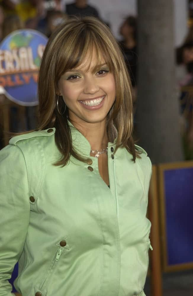 Actress Jessica Alba flashed a beautiful smile that complemented her green jacket and loose layered hairstyle that has a slight tousled and bangs at the world premiere of 2 Fast 2 Furious at the Universal Amphitheatre, Hollywood on June 3, 2003.
