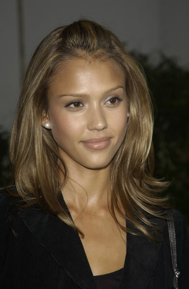 Actress Jessica Alba paired her black smart casual outfit with a simple yet elegant straight shoulder-length brown half-up hairstyle with subtle layers at the world premiere of The Rundown at Universal Studios in Hollywood on September 22, 2003.