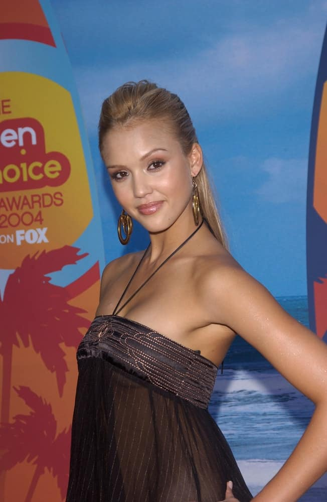 Jessica Alba paired her sexy and stunning outfit with a slick and brushed back sandy blond half-up hairstyle at the 2004 Teen Choice Awards at Universal Studios in Hollywood on August 8, 2004.