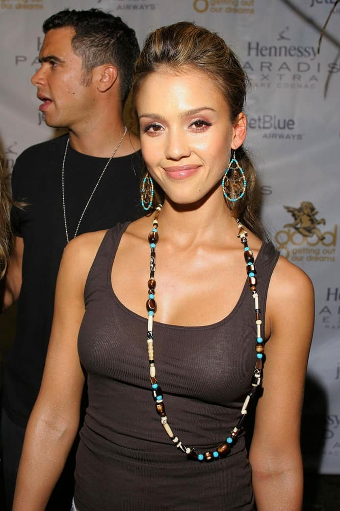 Jessica Alba was at the Kanye West GOOD MUSIC MTV VMA Pre-Party held at the The Shore Club in Miami, FL on August 27, 2005. She wore a simple black casual outfit to pair with her highlighted low ponytail with a slight tousle.