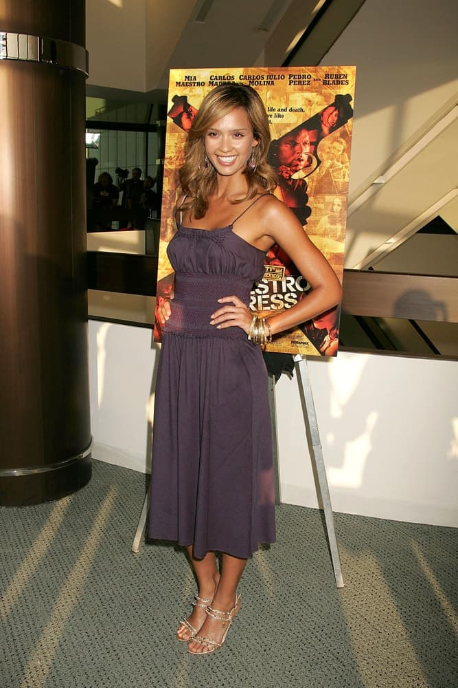 Jessica Alba was quite lovely with her Chanel shoes at the SECUESTRO EXPRESS Miramax screening held at the Pacific Design Center Silver Screen Theater on August 03, 2005. She paired this with a purple dress and long, tousled and wavy brown layers.