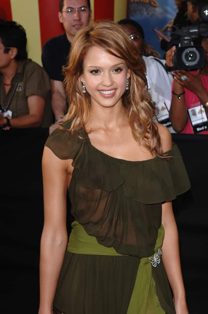 Actress Jessica Alba was at the 2005 MTV Movie Awards at the Shrine Auditorium on June 4, 2005 in Los Angeles, CA. She wore a stunning green sheer dress that went quite well with her long and loose tousled curly brown layers.