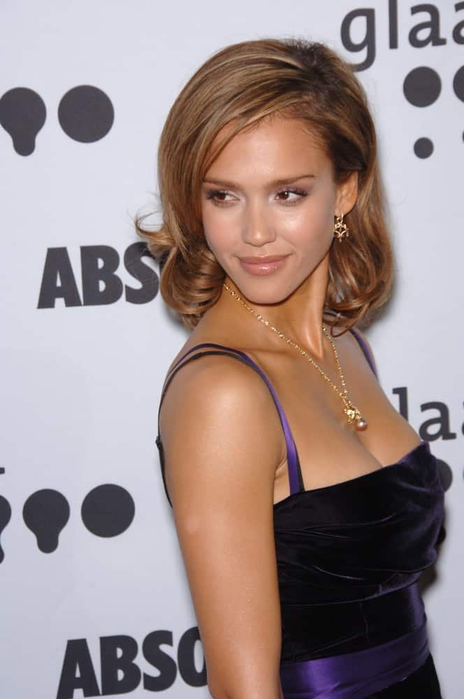 Actress Jessica Alba wore a black dress with purple trim to pair with her shoulder-length curly brown hairs that has layers and side-swept bangs at the 17th Annual GLAAD (Gay & Lesbian Alliance Against Defamation) Media Awards at the Kodek Theatre, Hollywood on April 8, 2006 in Los Angeles, CA.