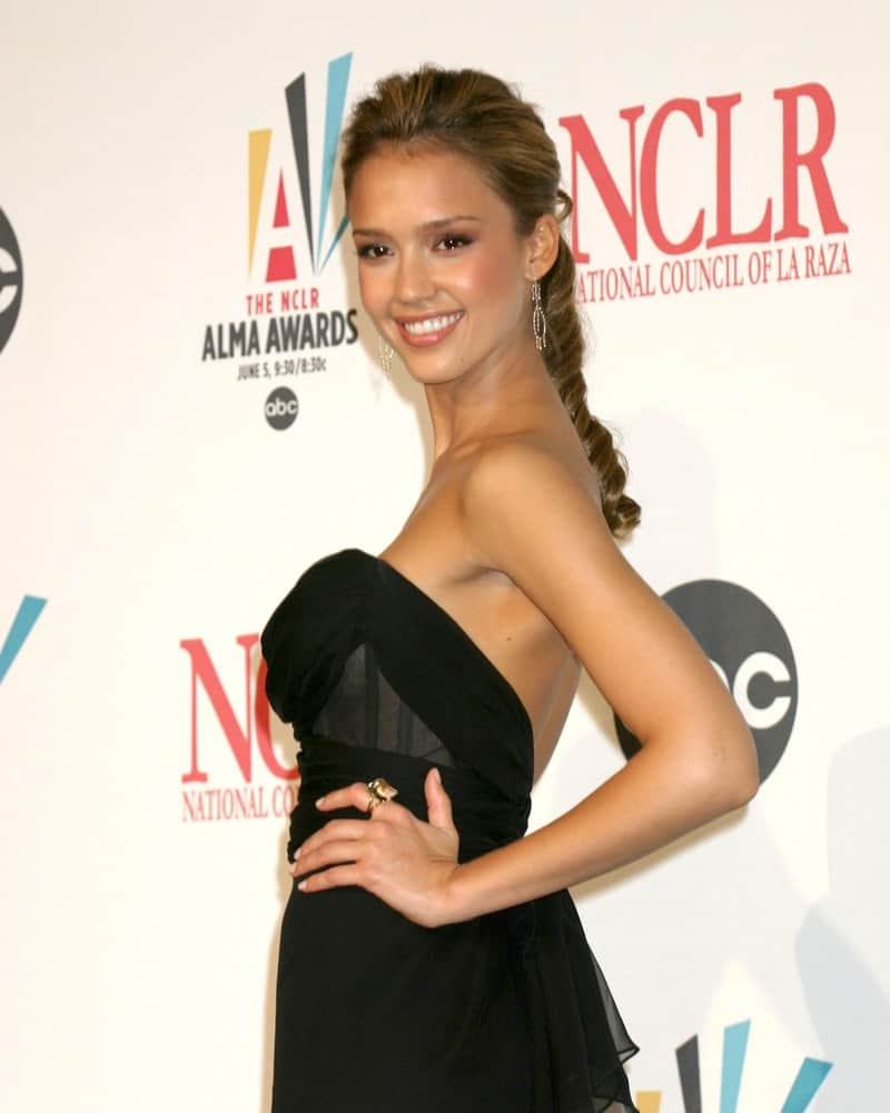 Jessica Alba attended the ALMA Awards 2006 held at the Shrine Auditorium in Los Angeles, CA on May 7, 2006. She paired her stunning black dress with a low ponytail hairstyle that has highlights and a spiraled tip.