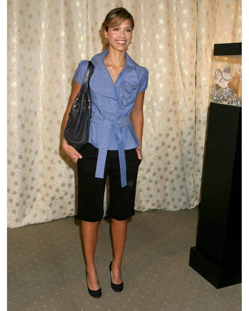 Jessica Alba paired her denim-colored blouse with an elegant upstyle bun hairstyle with loose side-swept bangs at the Diamond Fashion Show Preview in Beverly Hills Hotel Beverly Hills, CA on January 12, 2006.