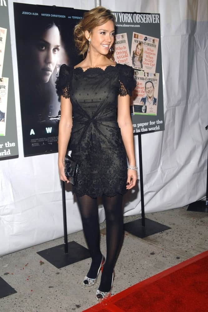 Jessica Alba wore a charming black Marchesa dress at The New York Observer Hosts the Premiere of AWAKE held at the Chelsea West Cinemas in New York, NY on November 14, 2007. She paired this with a messy and tousled bun hairstyle that has loose tendrils.