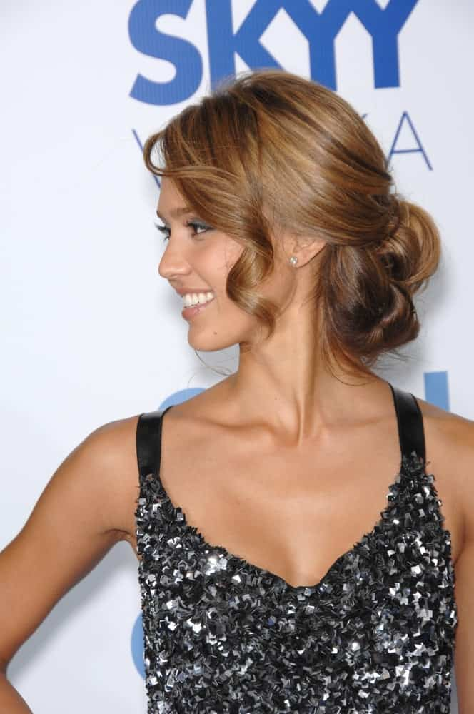 Jessica Alba wowed everyone with her detailed dress and elegant bun hairstyle with side-swept curly bangs and highlights at the Los Angeles premiere of her new movie