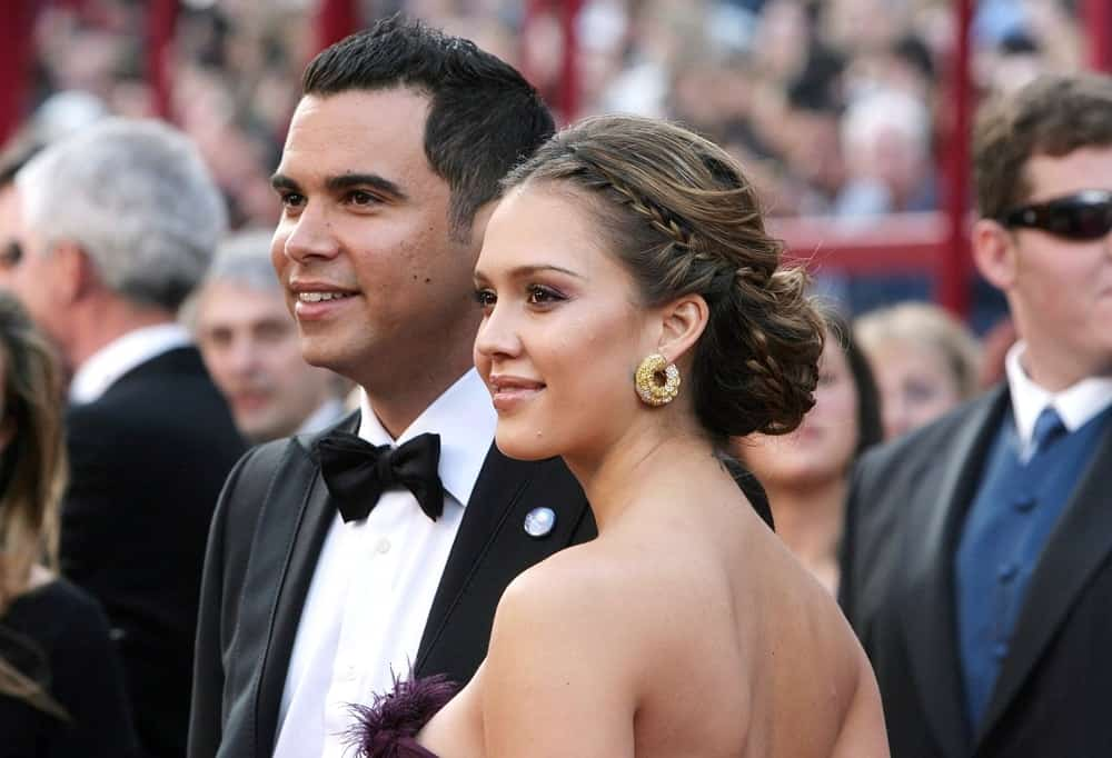 Cash Warren and Jessica Alba were at the 80th Annual Academy Awards Oscars Ceremony held at The Kodak Theatre in Los Angeles, on February 24, 2008. Alba wore Cartier earrings to match her elegant bun hairstyle that has braids incorporated within.