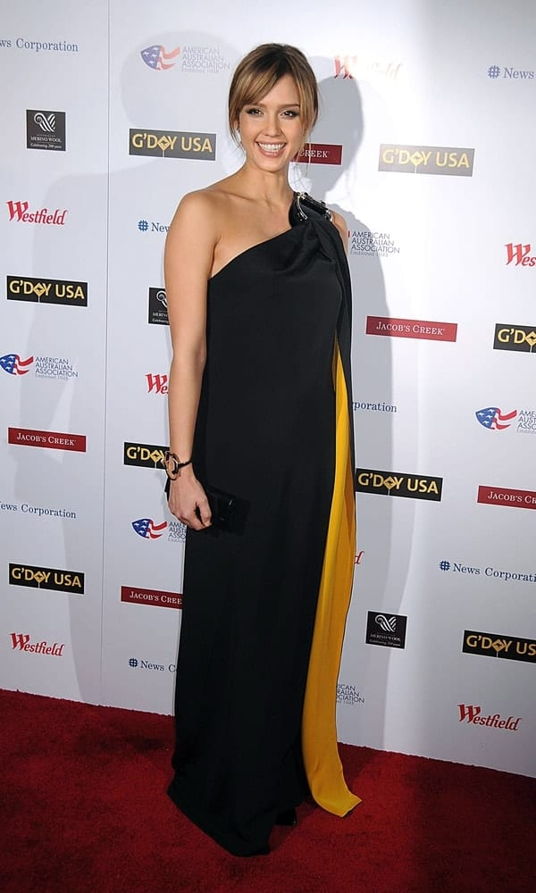 Jessica Alba wore a long Gucci dress at the 2008 G DAY USA Australia Week Benefit Dinner for Wildlife Warriors Worldwide held at the Lincoln Center, Time Warner Center in New York on January 22, 2008. She paired this with a messy and highlighted bun hairstyle with loose side bangs.