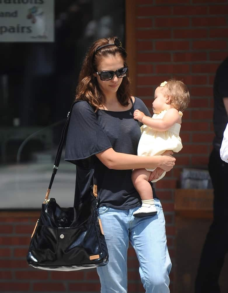 Jessica Alba and her daughter, Honor Marie Warren were see walking the streets of Beverly Hills on May 15, 2009. Alba was wearing a relaxed casual outfit with her cool sunglasses and tousled loose brown hairstyle with a headband and layers.