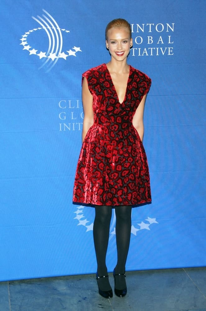 Jessica Alba wore a red Prada dress to go with her bold red lips and slick blond bun hairstyle at the 2009 Annual Meeting of the Clinton Global Initiative Cocktail Reception held at the MoMA Museum of Modern Art in New York on September 23, 2009.
