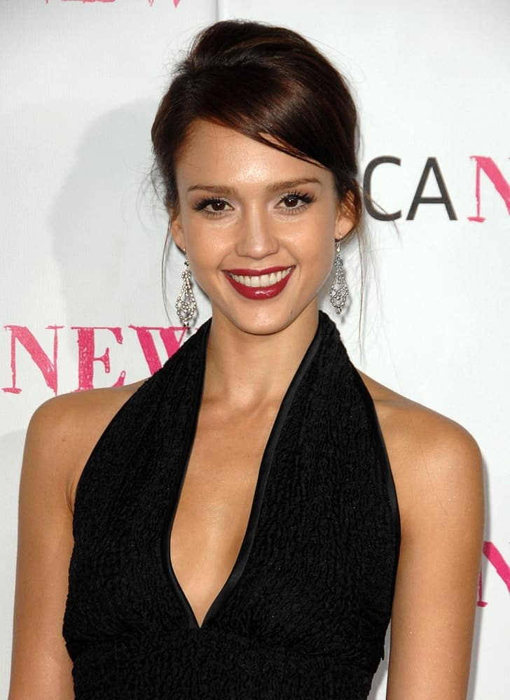 Jessica Alba paired her stunning black dress with a simple bun hairstyle that has loose side-swept bangs and tendrils at the MOCA 30th Anniversary Gala, The Museum of Contemporary Art - MOCA Grand Avenue in Los Angeles, CA on November 14, 2009.