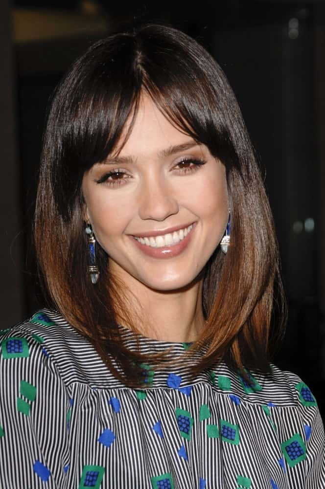 Jessica Alba wore vintage earrings from House of Lavande at the SUGAR Premiere held at the Pacific Design Center in Los Angeles, CA on March 18, 2009. She paired this with a straight shoulder-length layered hairstyle that has a loose and highlighted finish.