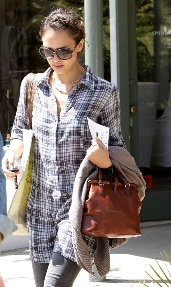 Jessica Alba was spotted walking the streets of Brentwood, CA on April 13, 2010. She was seen wearing a casual plaid outfit that she paired with a pair of cool sunglasses and neat upstyle bun hairstyle incorporated with braids at the side.