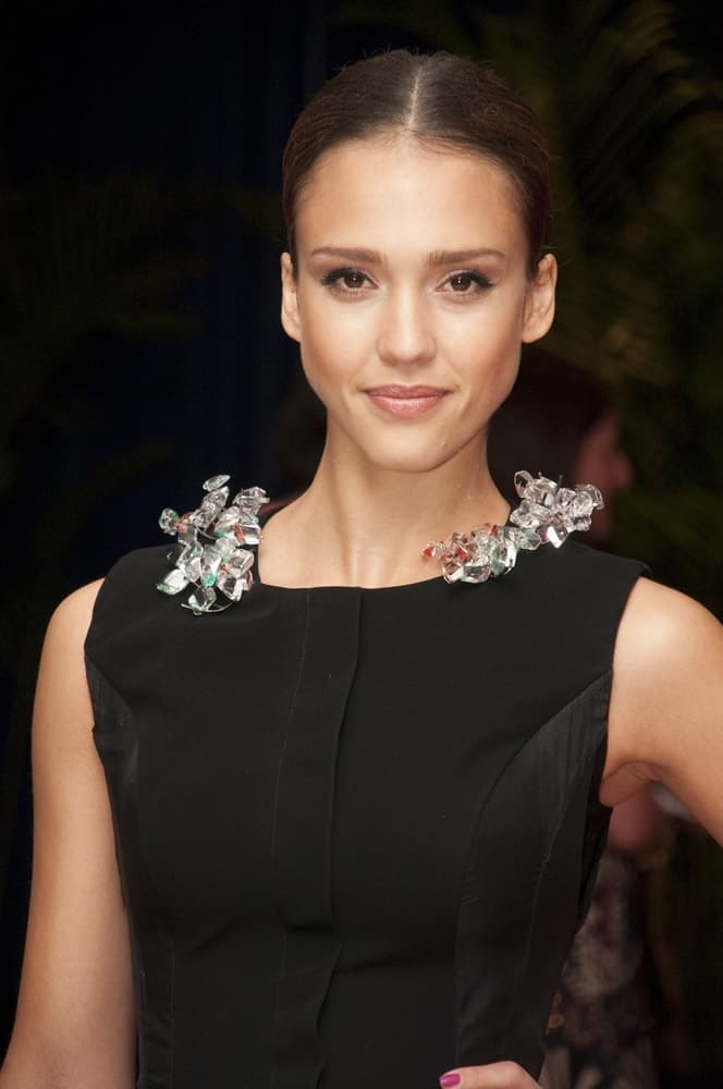 Jessica Alba wore a Marios Schwab bejeweled gown at the White House Correspondents' Association Annual Dinner in Washington Hilton Hotel, Washington, DC on May 1, 2010. She paired this with a neat and slick raven bun hairstyle and a brilliant smile.