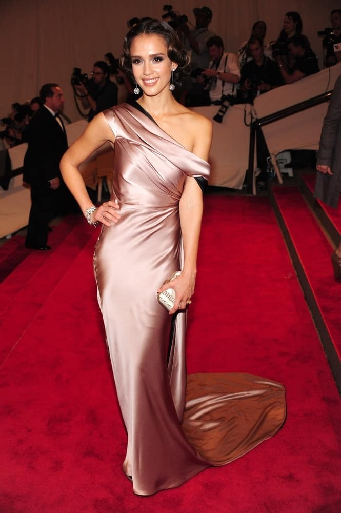 Jessica Alba at the Part 2-American Woman Fashioning a National Identity Benefit Gala for the Costume Institute, The Metropolitan Museum of Art in New York on May 3, 2010. She wore an elegant silk dress that paired quite perfectly with her bun hairstyle that has vintage curls on the sides.