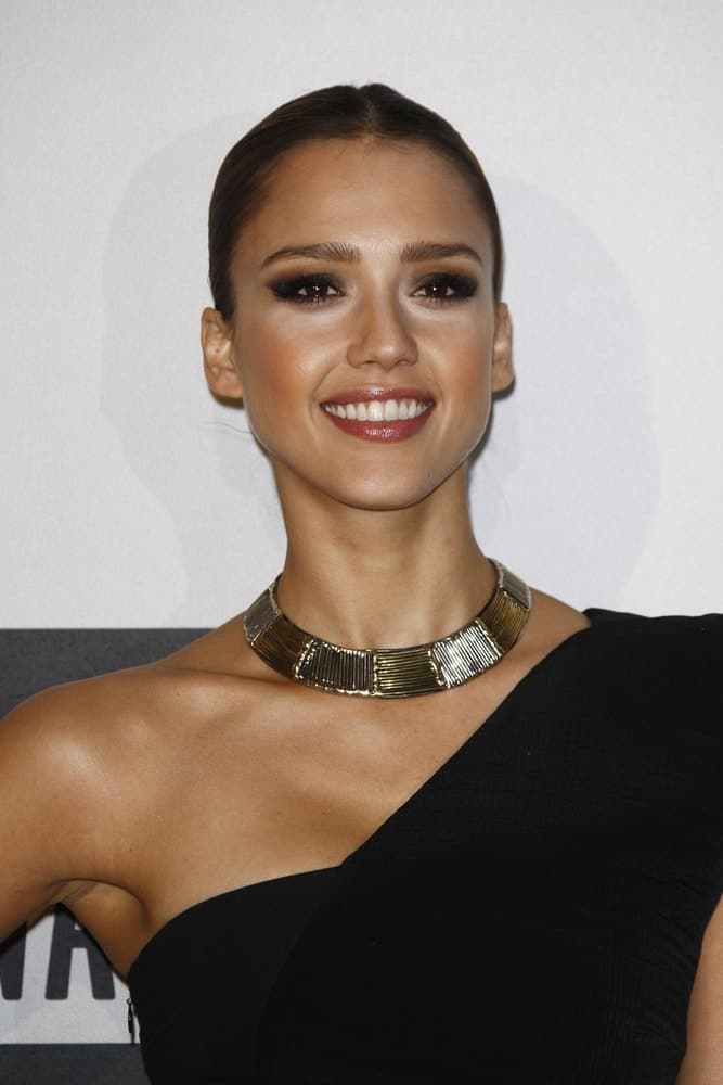 Jessica Alba's raven slick hairstyle paired quite perfectly with her confident smile and elegant black dress at the 2010 American Music Awards held at the Nokia Theater on November 21, 2010 in Los Angeles, California.