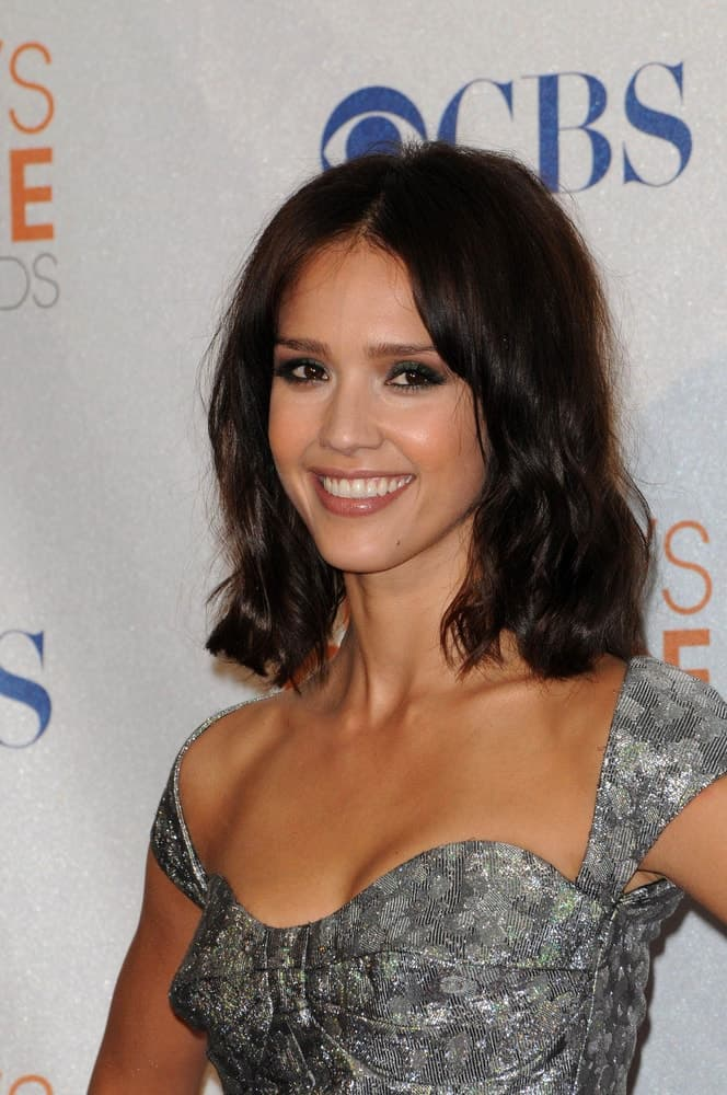 Jessica Alba was at the 2010 People's Choice Awards Press Room, Nokia Theater L.A. Live in Los Angeles, CA on January 6, 2010. She wore a stylish gray dress that matched well with her shoulder-length tousled bob hairstyle with subtle waves.