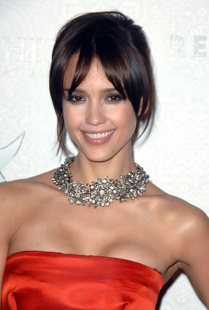 Jessica Alba flaunted her gorgeous diamond necklace with a simple red strapless dress and a messy bun hairstyle that has loose tendrils and long bangs at The Art of Elysium's Annual HEAVEN Gala in 9900 Wilshire Blvd, Beverly Hills, CA on January 16, 2010.