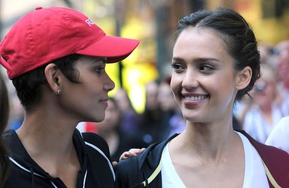Halle Berry and Jessica Alba were at a public appearance for the 13th Annual EIF Revlon Run/Walk For Women in Times Square to Central Park, New York, NY on May 1, 2010. Alba wore her casual running clothes with her neat upstyle bun hairstyle with braids.