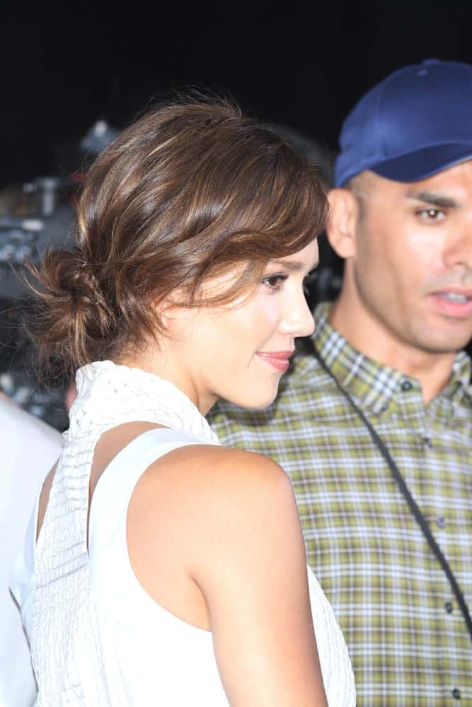 Jessica Alba attended the Boss Black Show during the Spring/Summer 2011 Mercedes-Benz Fashion Week on July 8, 2010 in Berlin, Germany. She came wearing a stunning white dress with her messy and highlighted low bun that has loose tendrils.